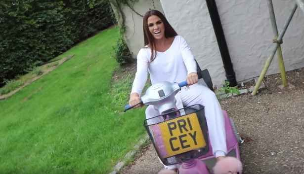 Katie Price shows off customised pink mobility scooter after being banned from driving: 'Ther... #pinkrangerovers #pinkrangerovers