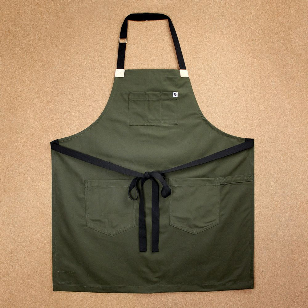 Hedley & Bennett Work Apron— This apron is made of sturdy brushed canvas in a deep moss green color. Black straps and raw leather give it a little extra style. Three pockets on the bib are perfect for holding pencils or thermometers. Two solid front pockets are great for notebooks and other essentials. A towel loop on the side adds extra function.