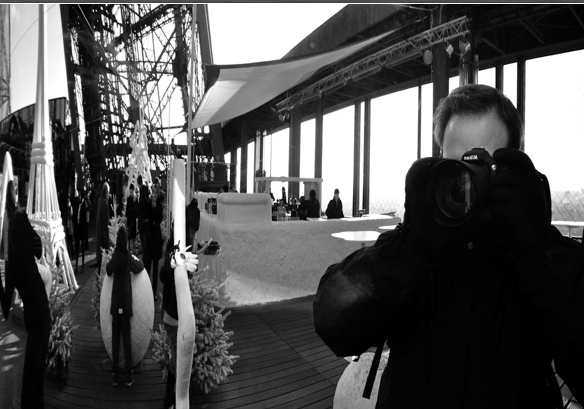 Photographer in the mirror on the Eiffel tower.