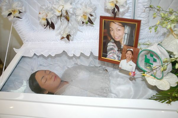 mariglo pascual in her open casket during her funeral memento