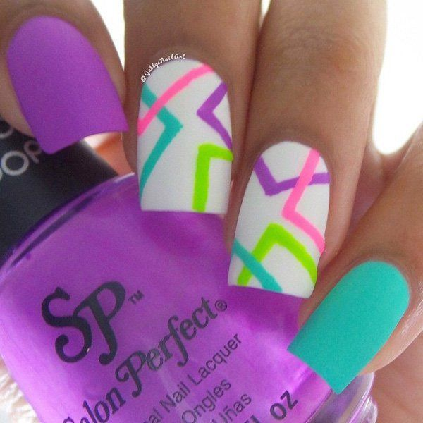 A simple yet unique looking abstract nail art design. The bright colors  help make the design look more fun and easy to recreate. - A Simple Yet Unique Looking Abstract Nail Art Design. The Bright