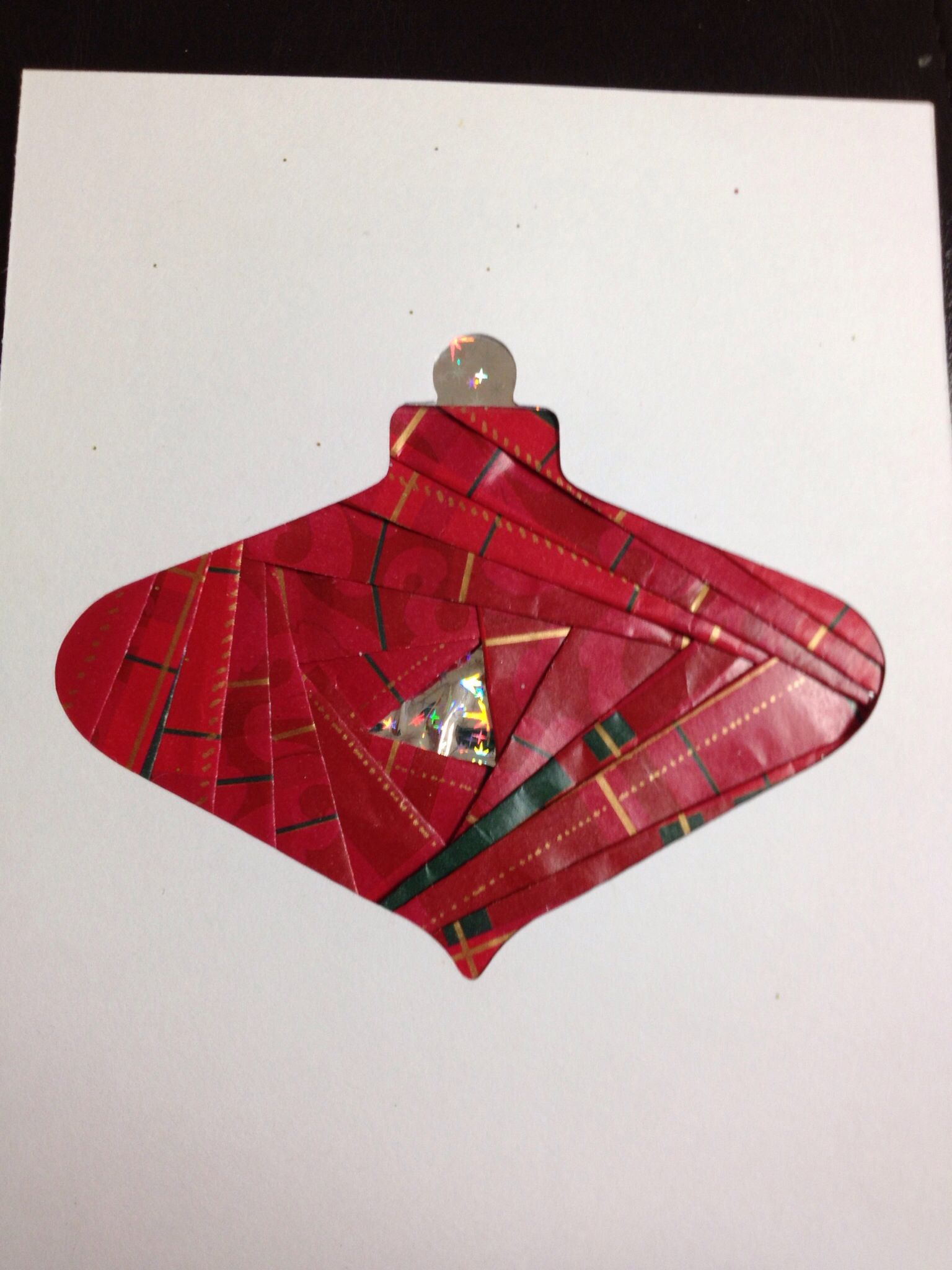 Iris folding using Cricut cut out and Christmas wrapping paper For