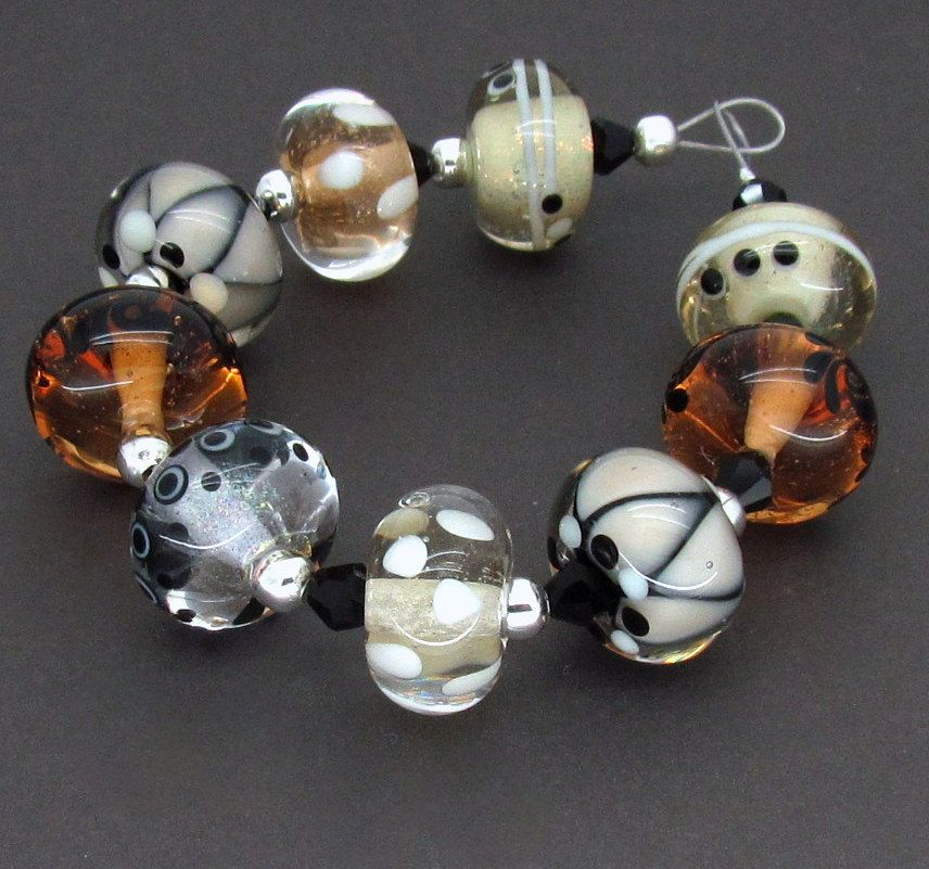 Peach Champagne  Lampwork Glass Bead Peach Ivory BlackSRA FHFteam. £24.50, via Etsy.