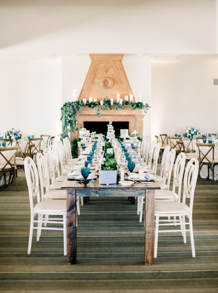 Disney-inspired wedding details - Farm styled wedding table setting with white wedding chairs #weddingdetails #weddingdecor #weddingbackdrop #fabricdraped