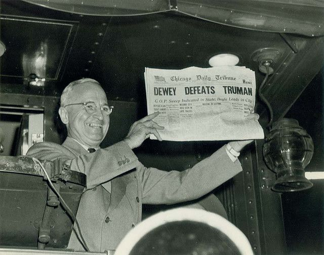 "Harry S. Truman with ""Dewey Defeats Truman"" headline at Union Station in St. Louis the morning after Election Day, 1948."
