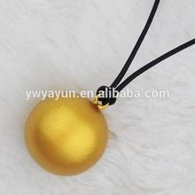 Golden ball pendant