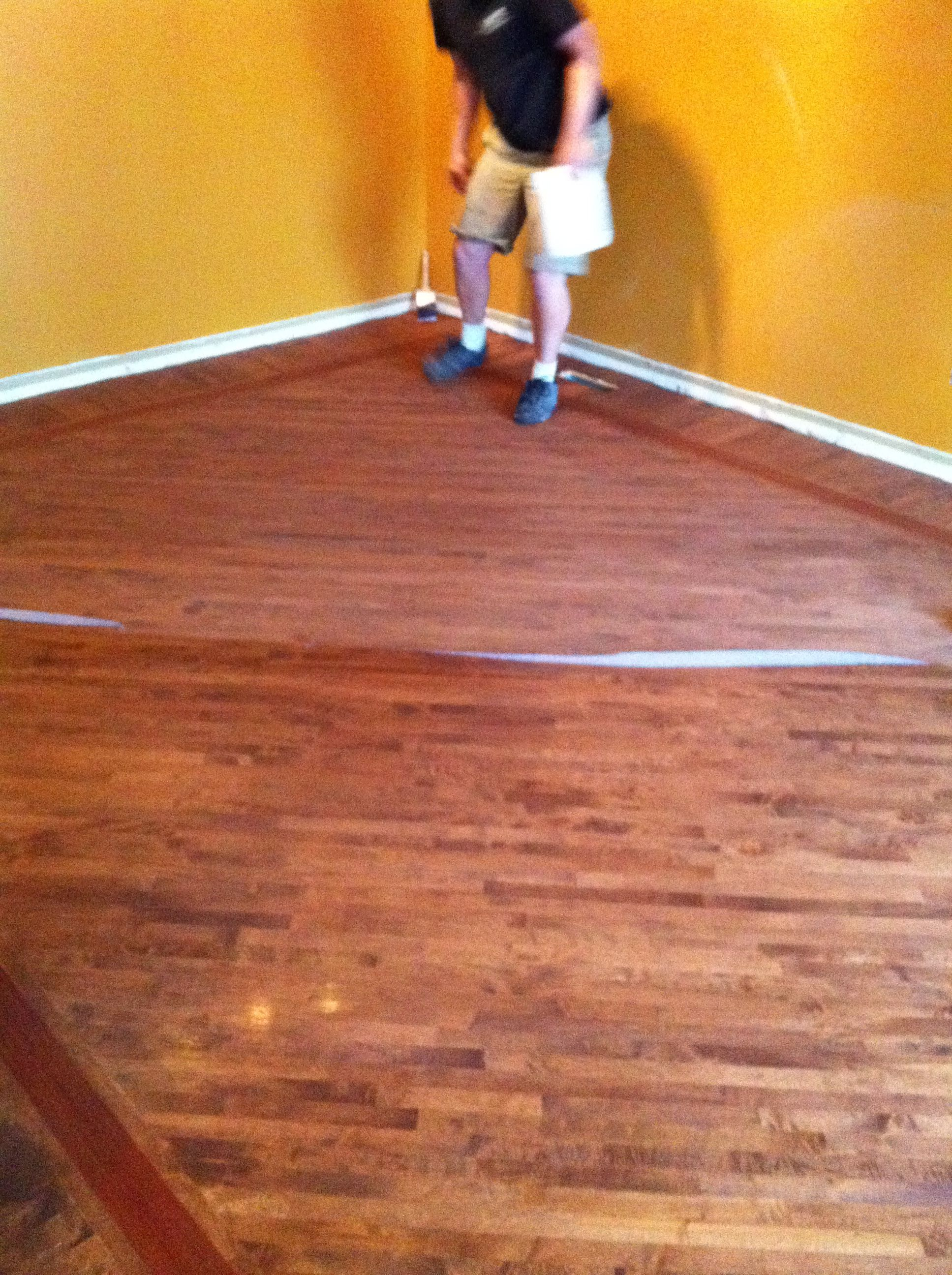 Stained maple floor with boarder work, application of