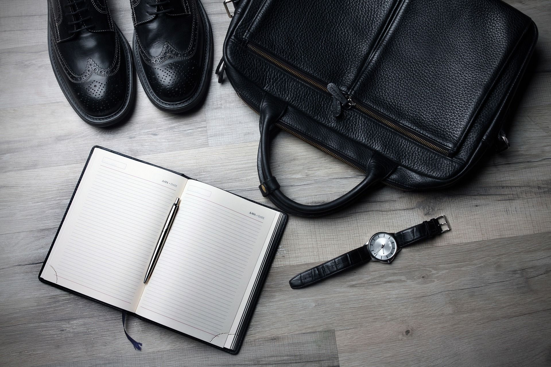Smart shoes and work bag on the floor