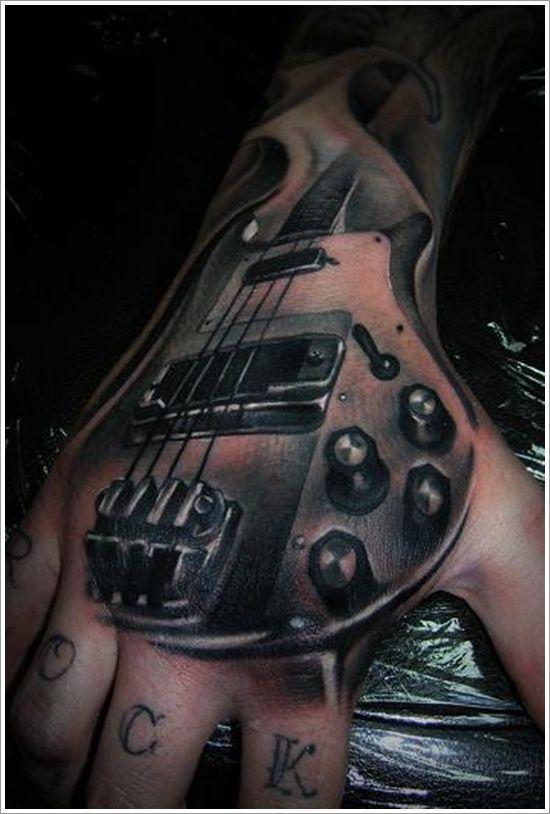 24 Great Guitar Tattoo Designs Amazing Bass Guitar Tattoo Designs On Hand Tattoo Design Inspiration Hand Tattoos Guitar Tattoo Design Tattoo Hurt