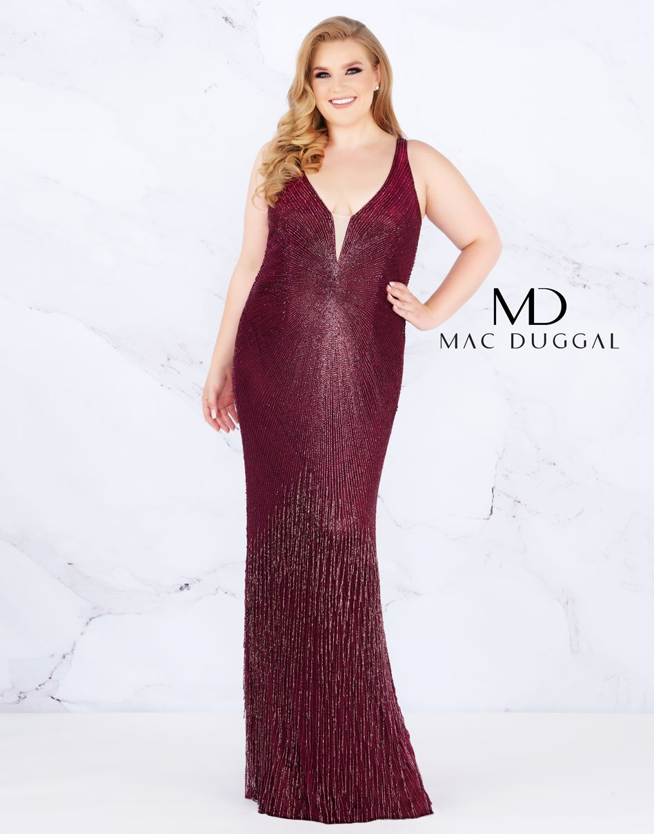 d062ff3a5833 This amethyst plus size prom dress truly delivers with waterfall fringe,  liquid beading, and a V-neck.