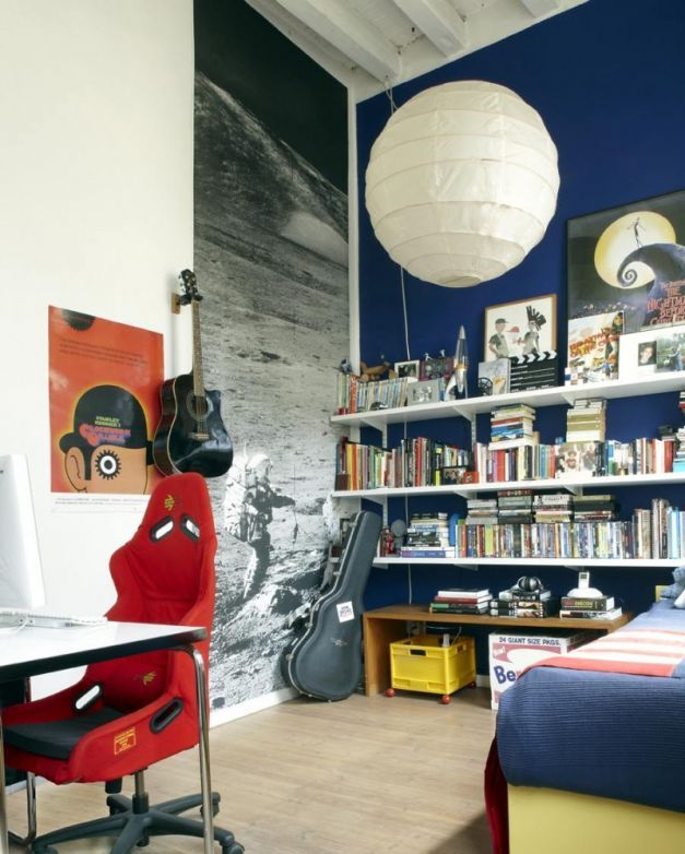Contemporary New York Loft Style: Bedroom With Blue Wall And Red Chair