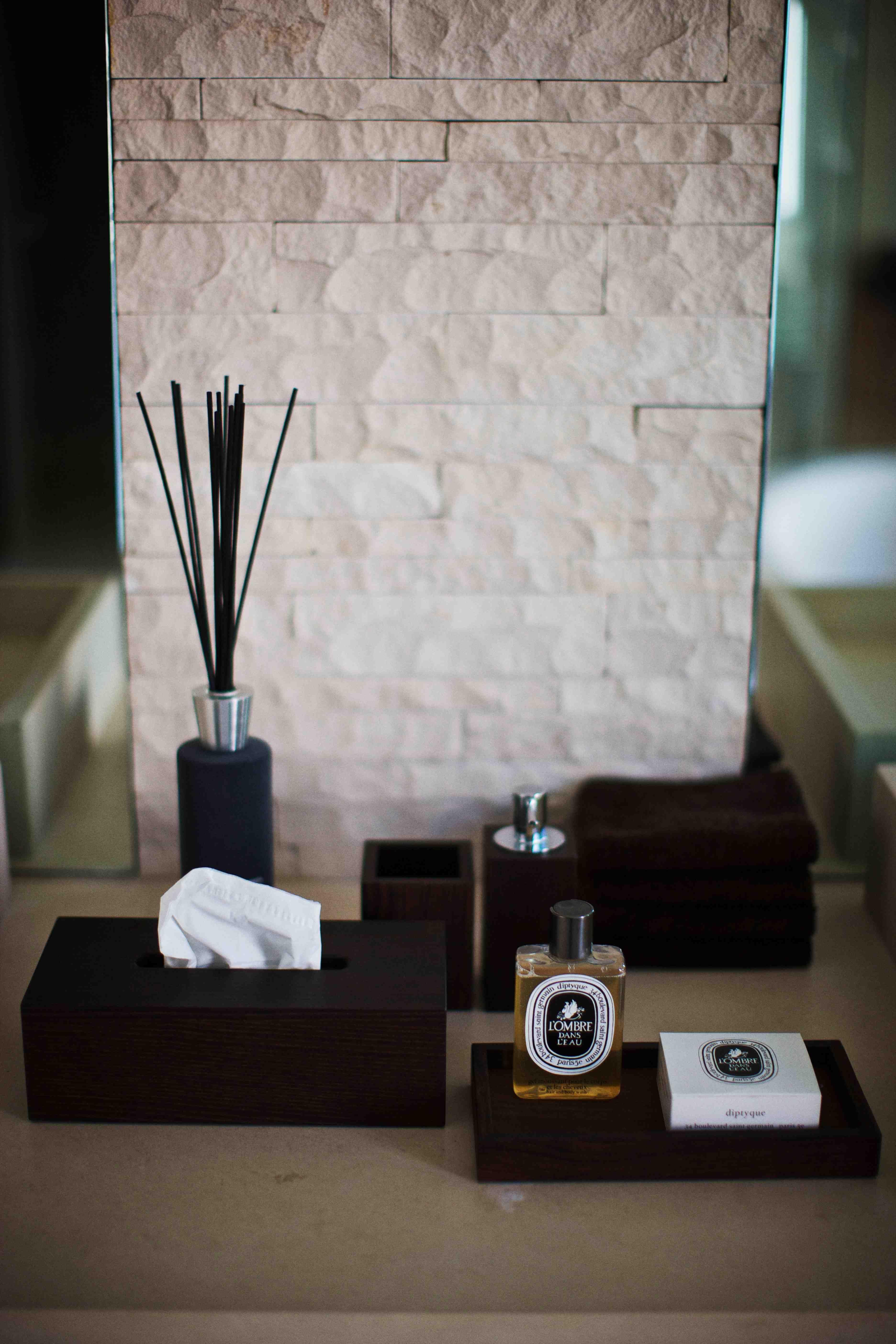 matt black bathroom accessories and fabulous pale white stone tiles ...