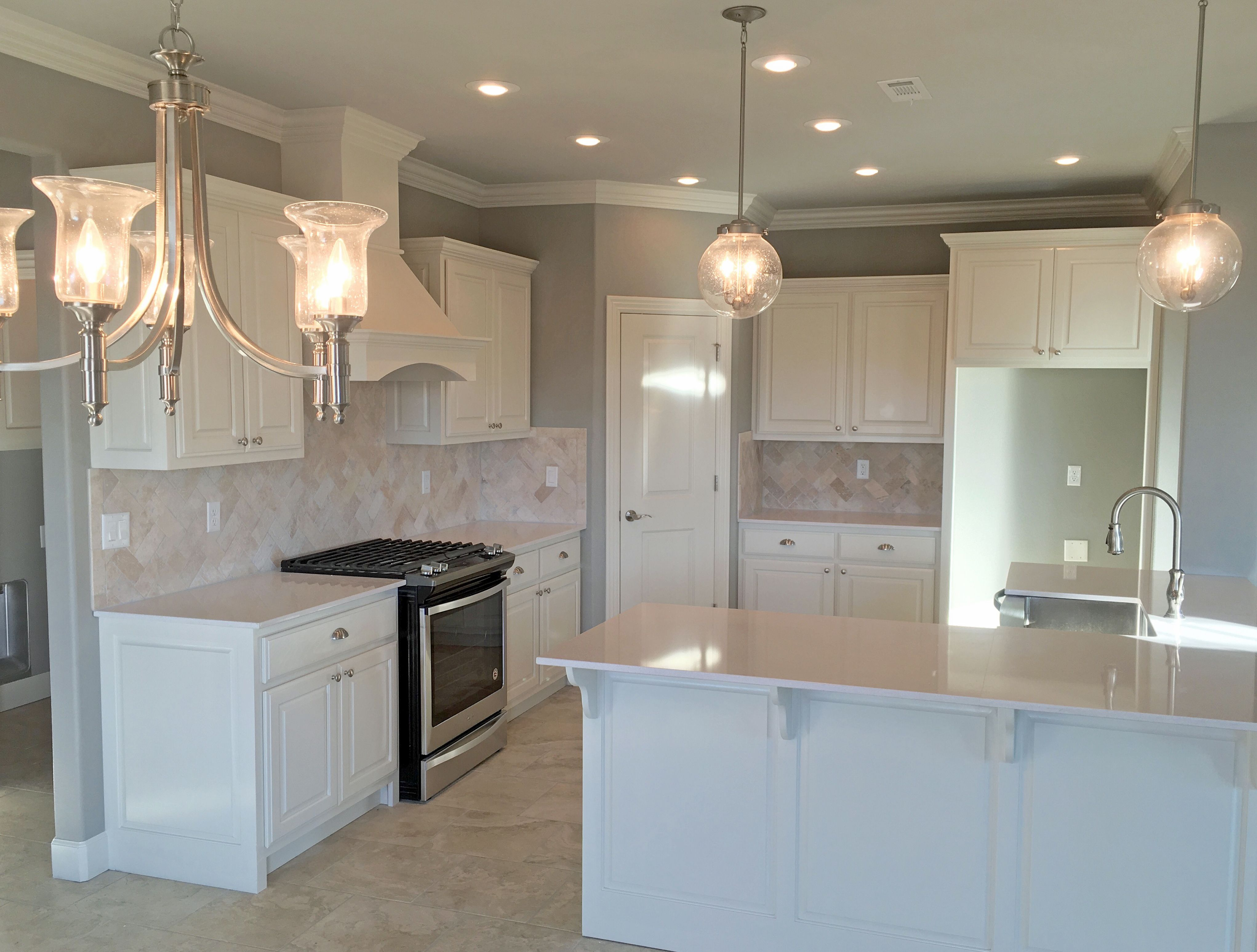 - White Kitchen With Satin Nickel Fixtures, Pendant Lights