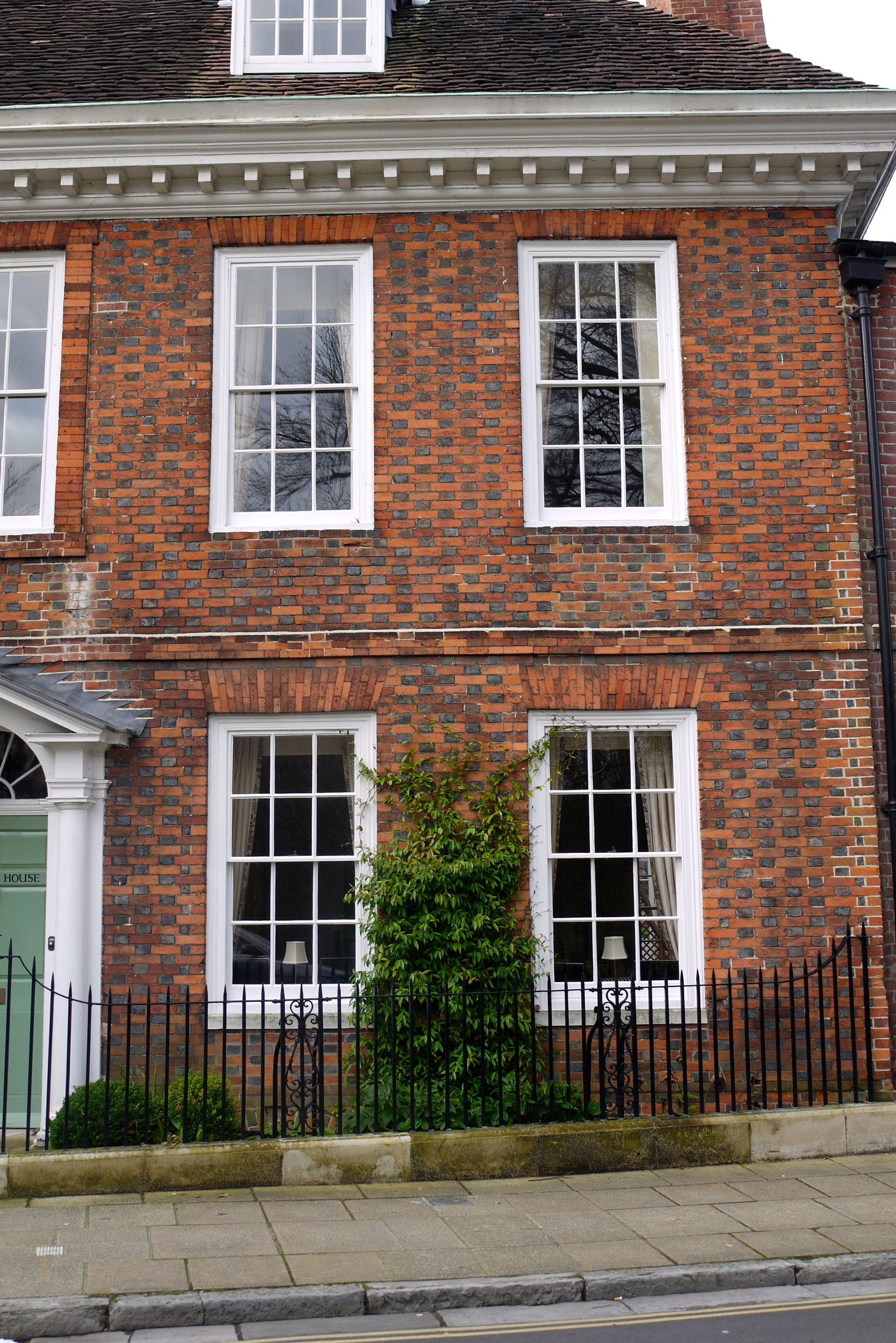 Georgian facade with dark glazed headers in flemish bond for Brick georgian homes