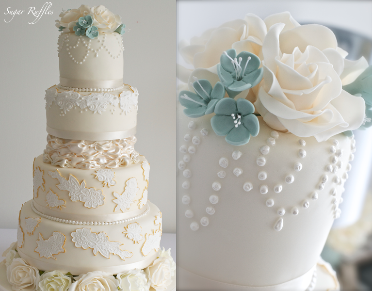 Wedding Cake With Lace Edged In Gold Billowing Satin Pearls And Sugar Flowers