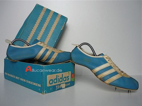 Adidas track shoes.  Mine had changeable spikes for perma track and cinder track.
