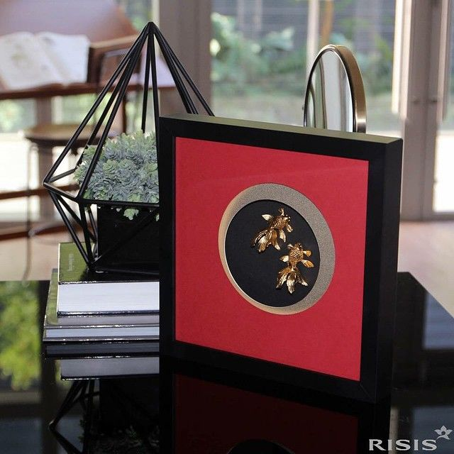 How about a pair of Ryukin goldfish — symbols of abundance and regeneration, framed beautifully in red to spice up your home? #homeanddecor #RISIS
