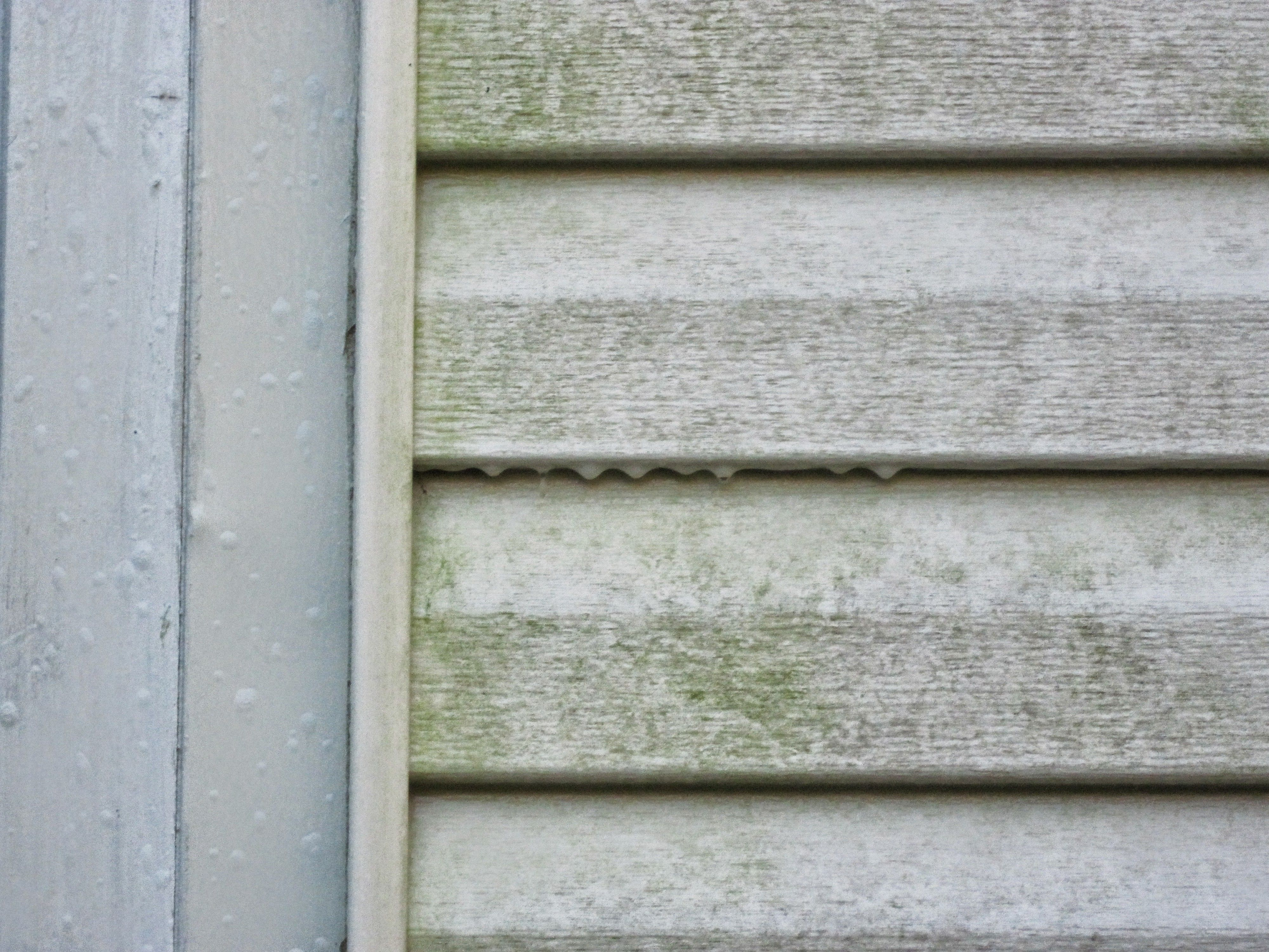 Dirty shutter before power washing by the go to crew before
