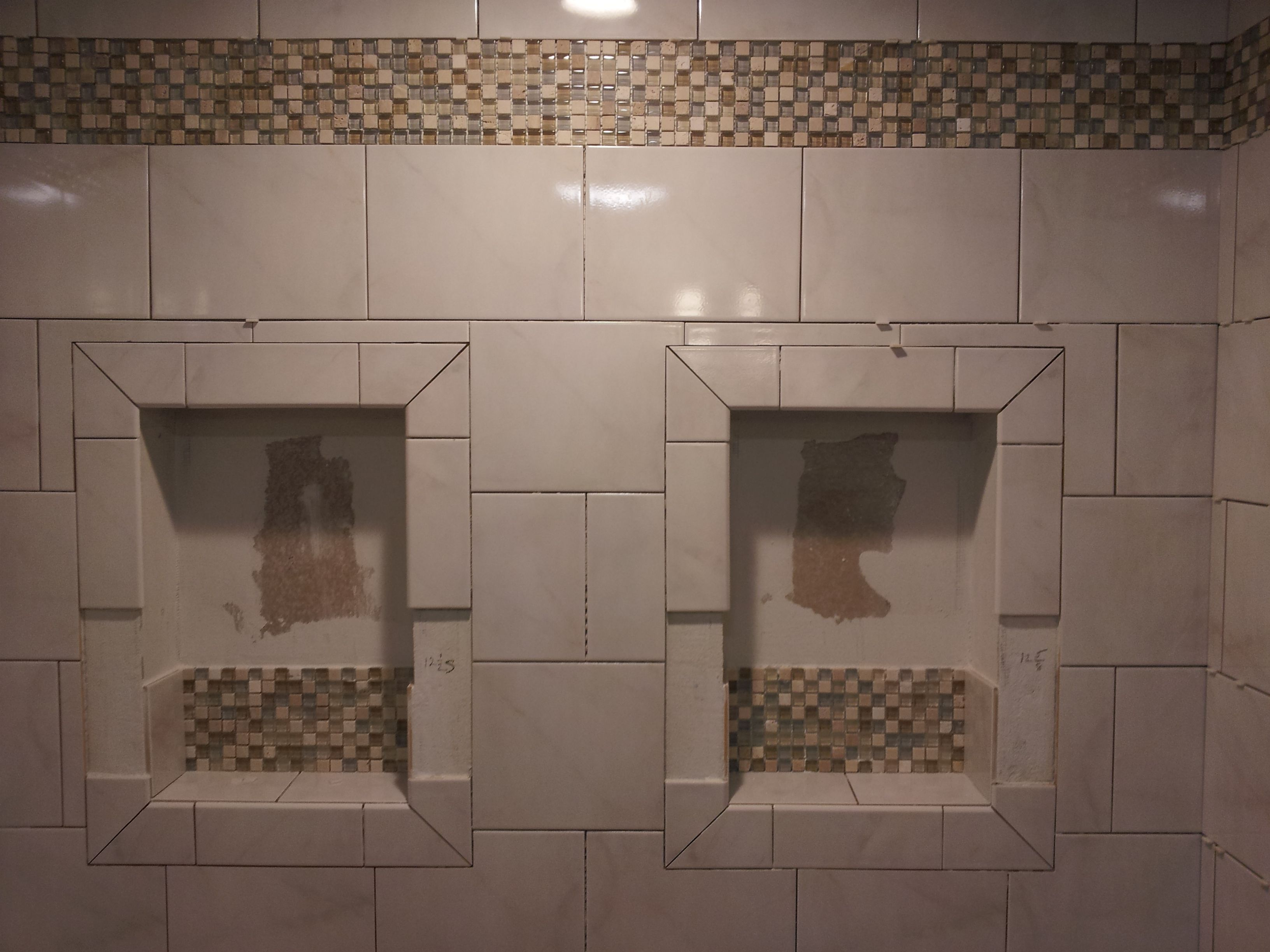 Custom Master Bath Shower Stall with double niches during the installation.