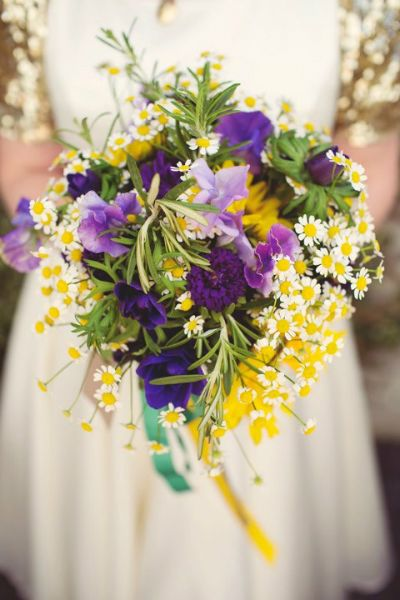 Bridal bouquet with sweet pea, chamomile, rosemary, sunflower, anemone, cornflower and aster. Image Hannah Millard
