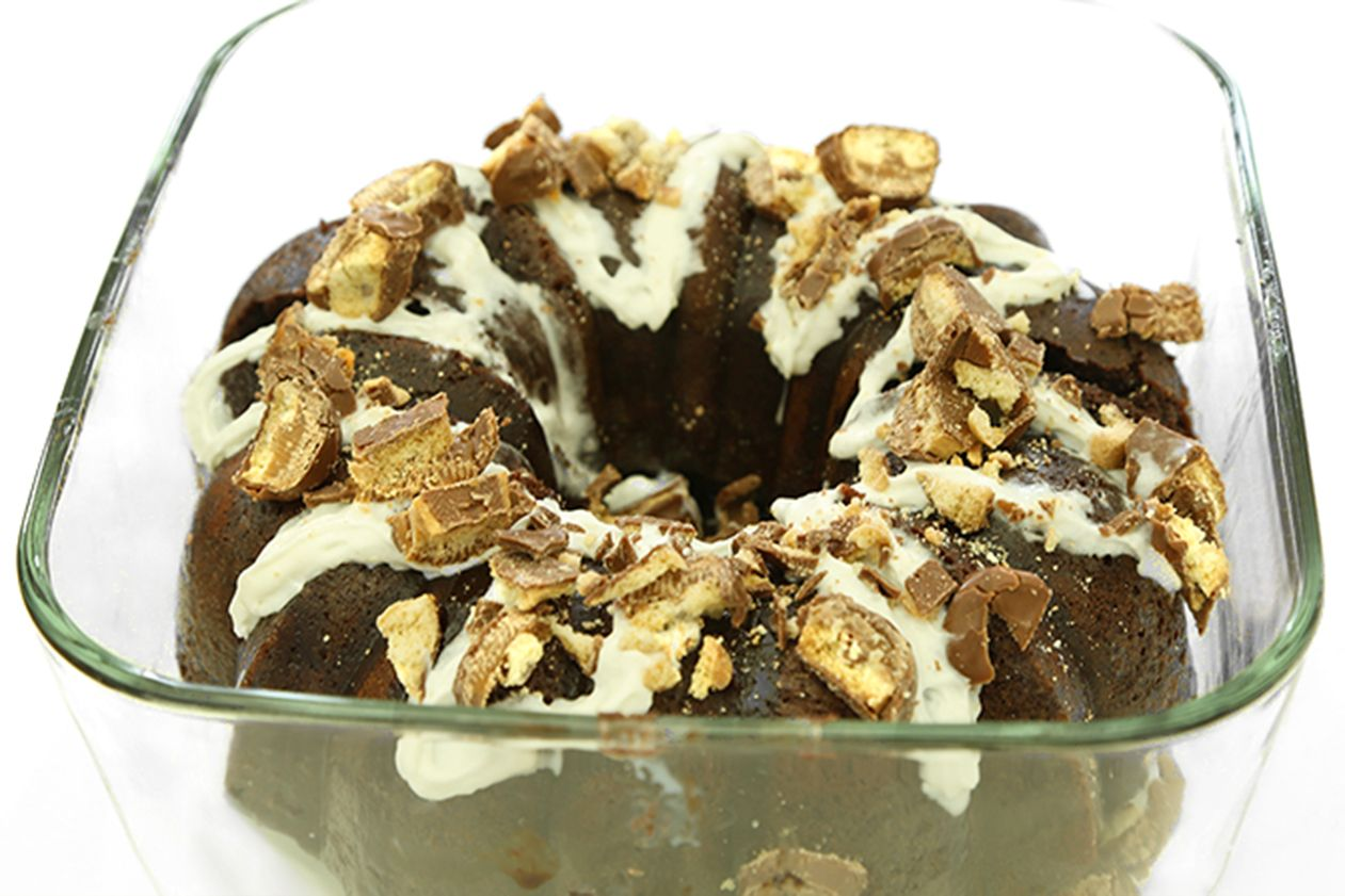 You Will Need:Round baking dish1 pack of Moist Supreme Devil's Food Cake Mix (or plain chocolate cake mix)Whatever ingredients your cake mix calls for – this varies, so look at the box!One can of Sweetened Condensed MilkWhipped creamCaramel Ice Cream ToppingTwix bars(chop for topping)Step 1 –