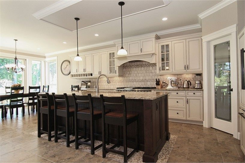 offwhite creamy cabinets wall color and nice wood island
