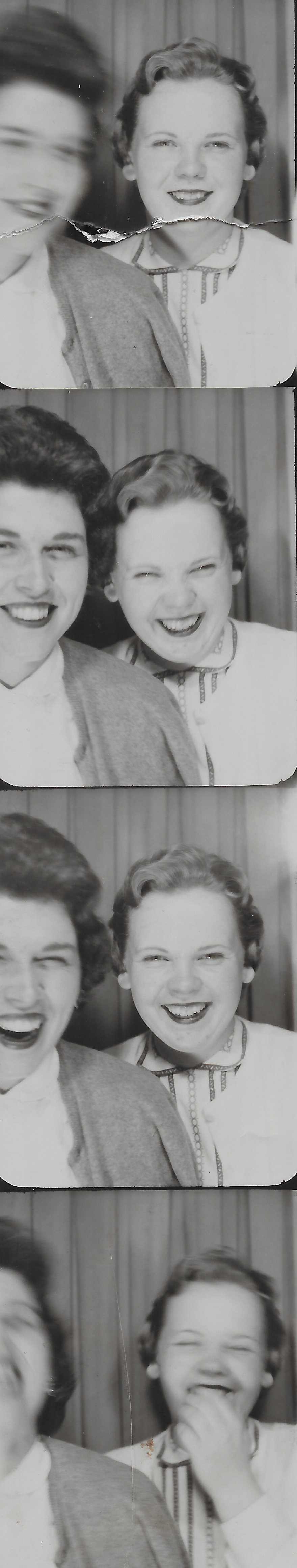 My grandma (on the right) and her friend in a photo booth 1958