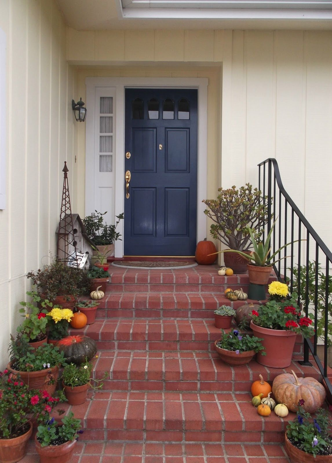Yellow house with blue door and red brick path back door - Front door colors for brick houses ...