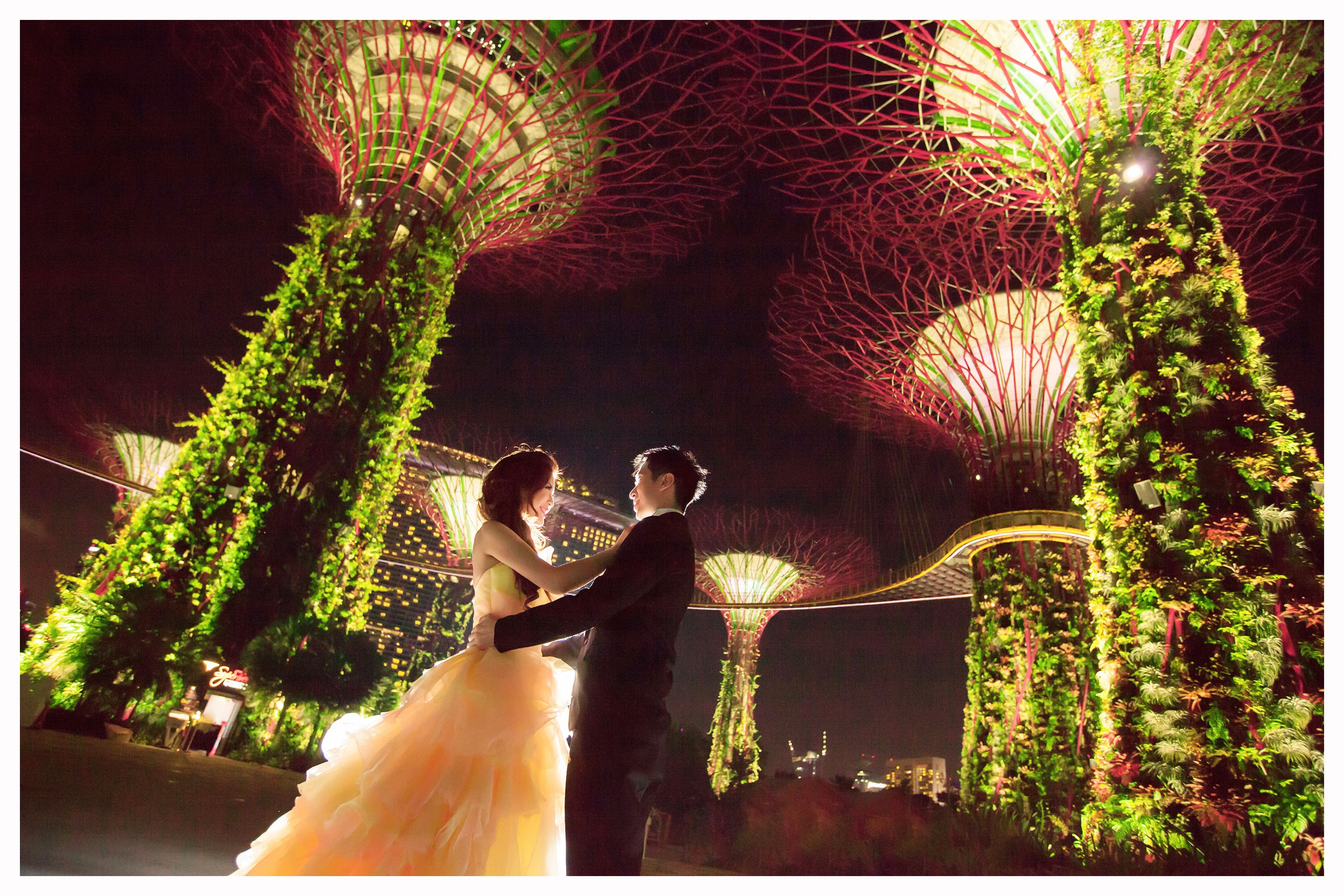 """Night shot amidst the lighted structures in """"Gardens By"""