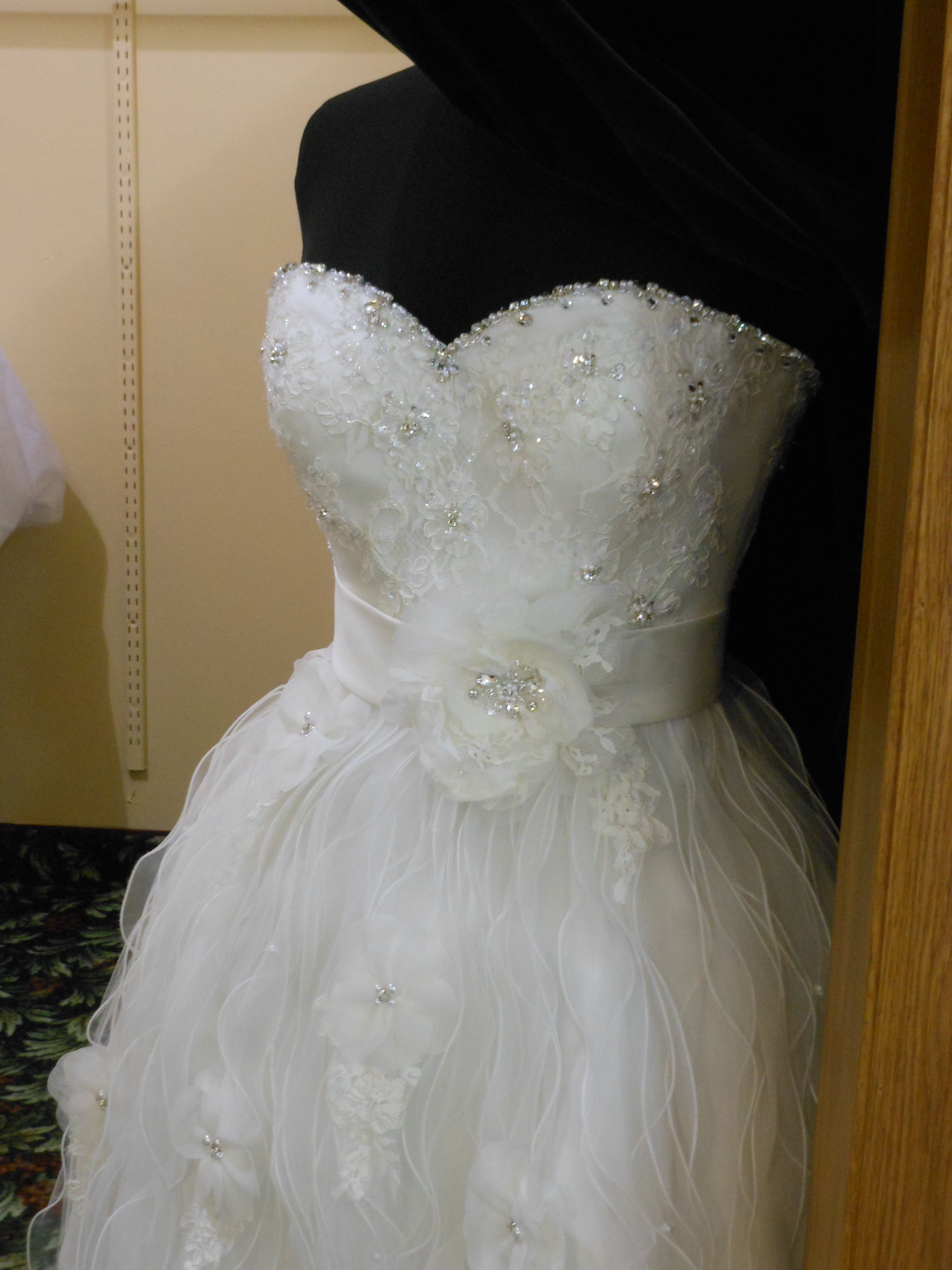 This short gown is just too adorable! Sweetheart neckline, fluttery layers, and a flower detail make it just right!