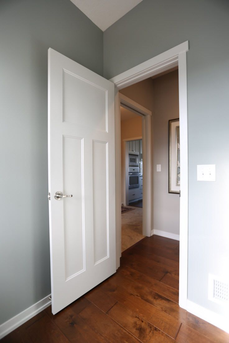 Interior Doors White Molded 3 Panel Door Against A Blue Grey Wall Bayer Built Woodworks