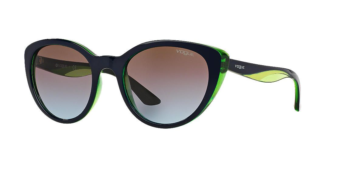 Make a bold statement in these colorful cat-eye frames from the Vogue Rainbow collection.  With a try-layer color effect, the collection features an exciting and whimsical play in waves of solid and transparent color. A solid black color at the temple tops flows into a pop of lime green in the middle which sits atop a more transparent yet colorful bottom layer.