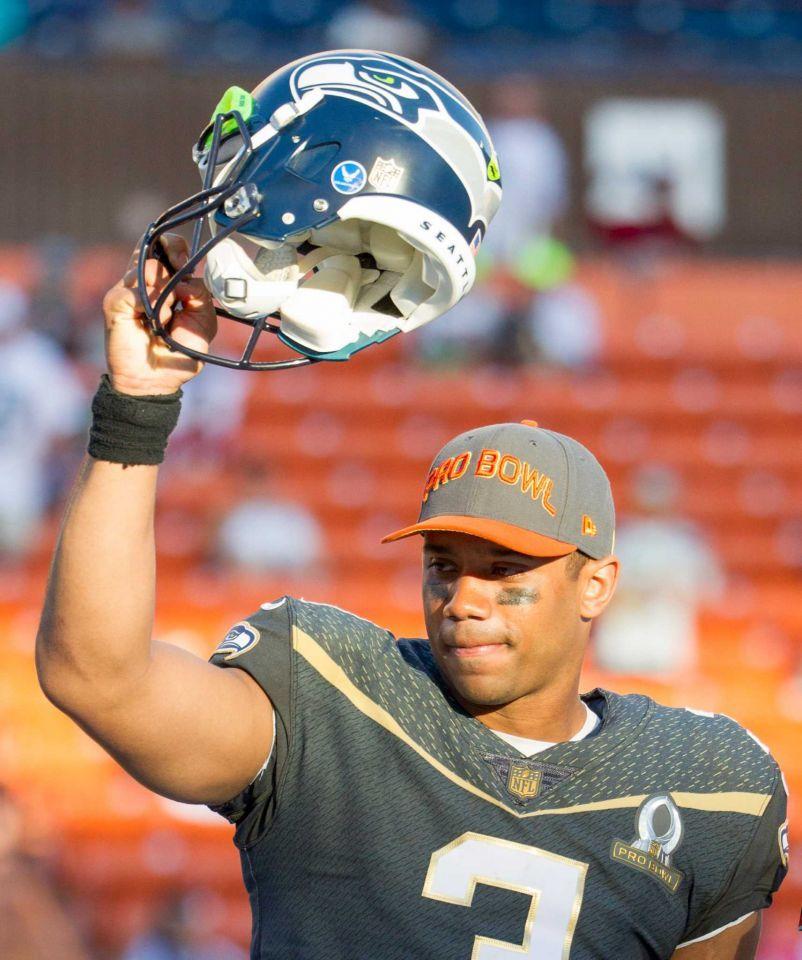 watch 0df41 94ee3 Seattle Seahawks quarterback Russell Wilson, of Team Irvin ...