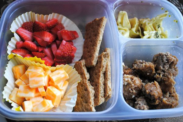 Strawberries and graham crackers, pasta, meatballs and cheese.