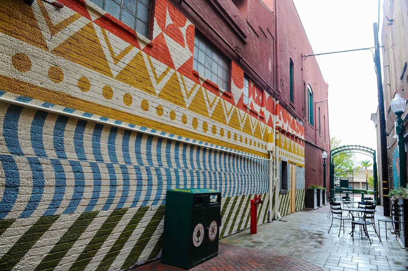 Orange street alley in living color with images