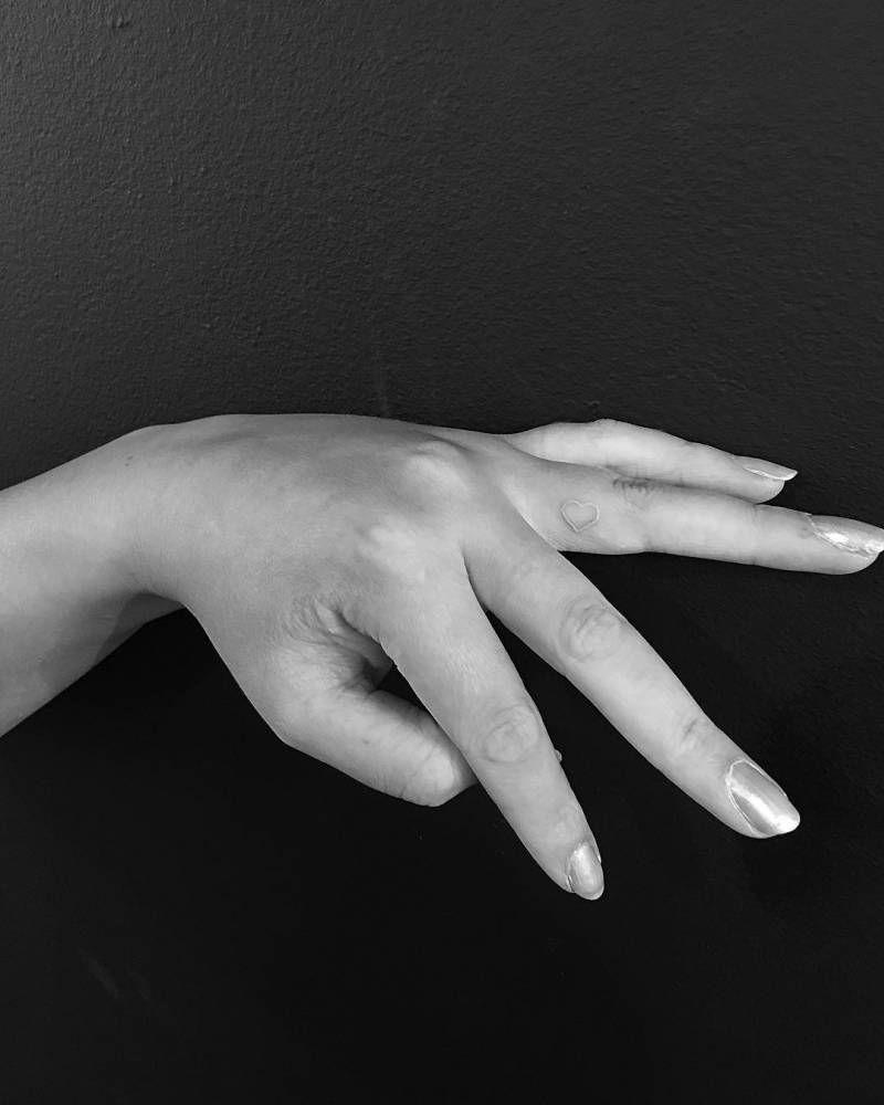 fb475eb4f White ink heart tattoo on the left ring finger. Tattoo Artist: Jon Boy ·  Jonathan Valena