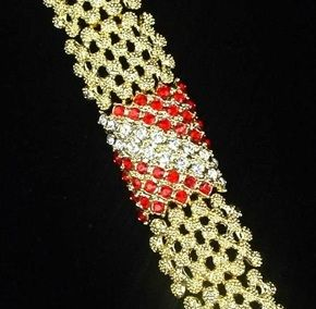 Ruby was Jacqueline Kennedy's birthstone and she received many gifts of jewelry featuring rubies. This was called her ruby and diamond stripe bracelet.