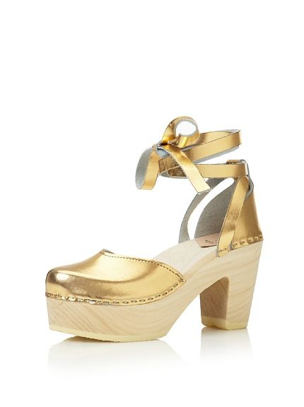 totally into this--loeffler randall's uta clogs in gold.