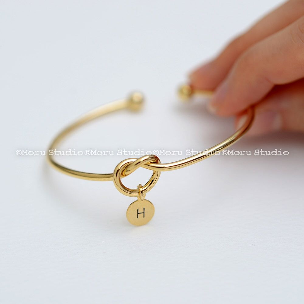 Love knot bangle bracelet with initial disc personalized heart knot