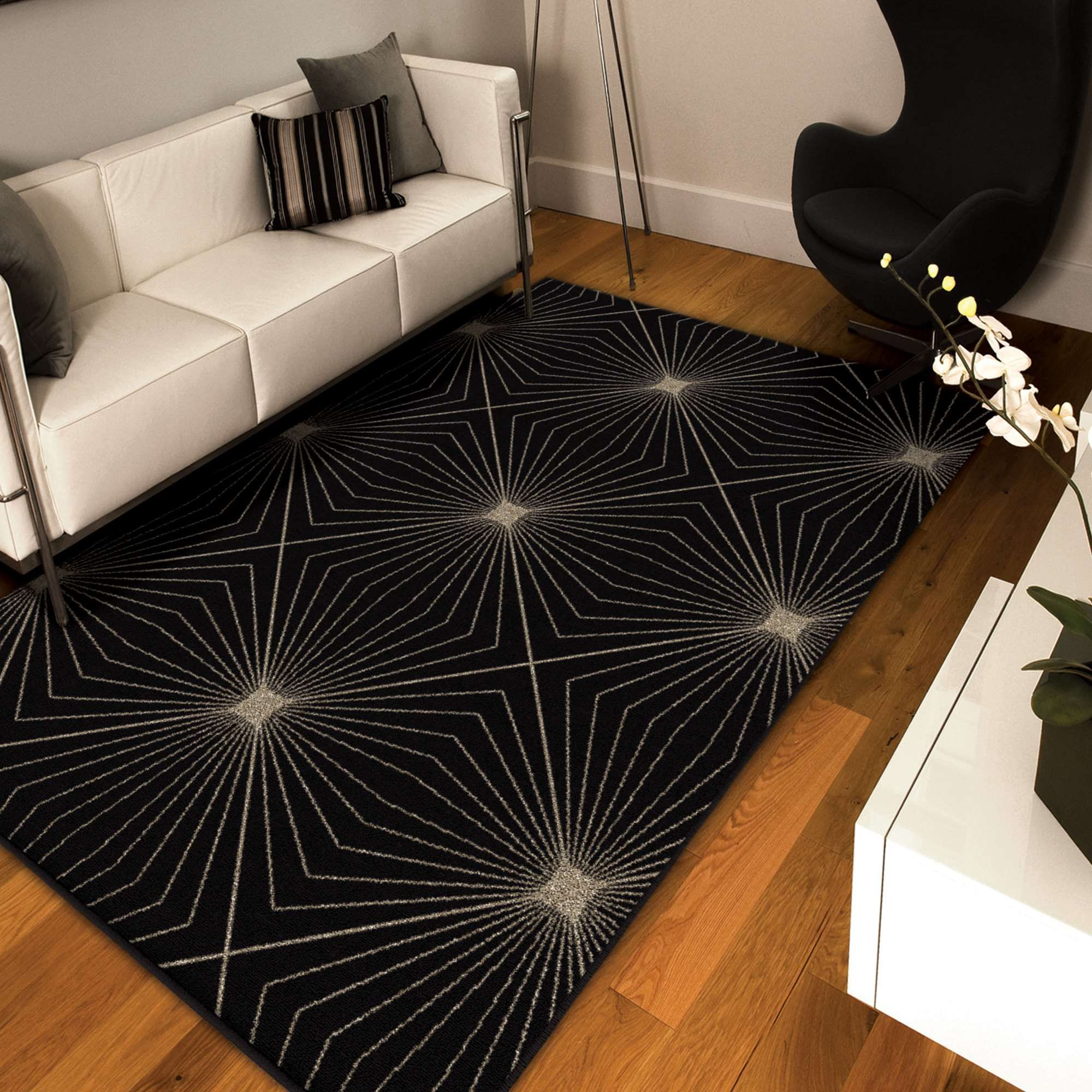 With attractive neutral colors, this Da Vinci Illusion Black Rug is a perfect complement to many decor styles. The Da Vinci collection joins contemporary blacks, diffused browns and tranquil creams, making this collection a vision of unique style