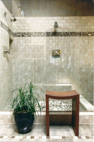 River rocks line the shower floor and textured tile with glass accents  create a tranquil feeling in this Asian style Zen bathroom. (via cathy  Chilton) Light ...