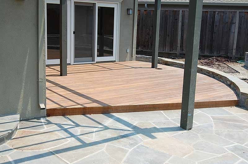 An Ipe Deck Next To A Flagstone Patio