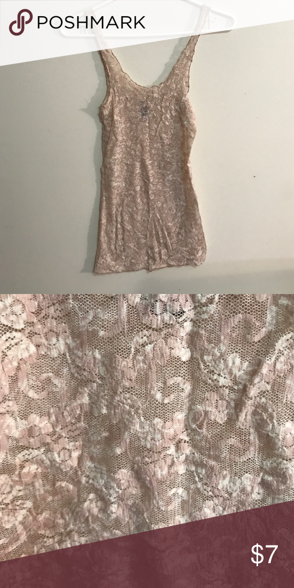 Pale pink and cream lace tank top Really pretty lace. Great with any outfit! Worn but in good condition. Free People Tops Tank Tops