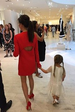 Victoria Beckham in red and adorable Harper