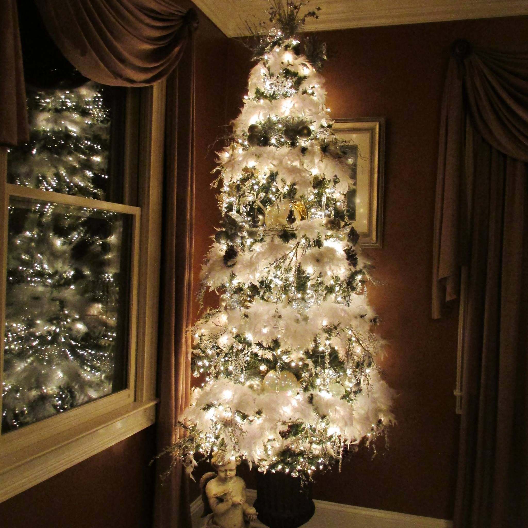 The Dining Room Tree Is Decorated With White Feathers, Large