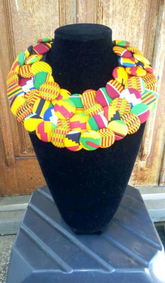 Check out this item in my Etsy shop https://www.etsy.com/listing/527967728/ankara-button-covered-necklace-kente
