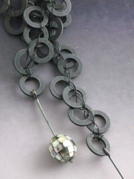 WILLYjewelry. Recycled, light-weight black washers, crocheted with electronic wire.  Green-tip-oyster shell mosaic beads on sterling wire hang on both ends. Casually tie, or use hidden toggle bar to connect.