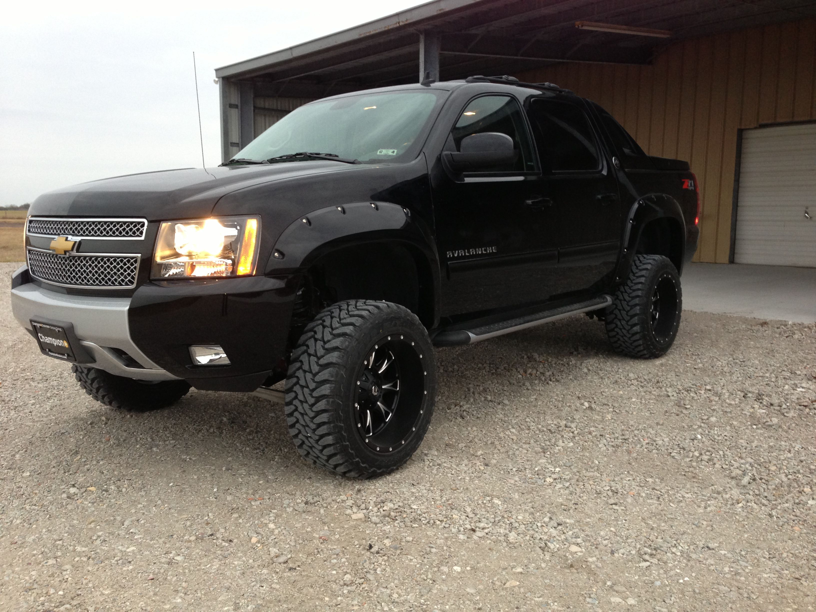 my 2013 avalanche with 6 bds suspension lift 33x12 5x20 toyo open country tires fuel throttle deep dish rims and matching black fender flares [ 3264 x 2448 Pixel ]