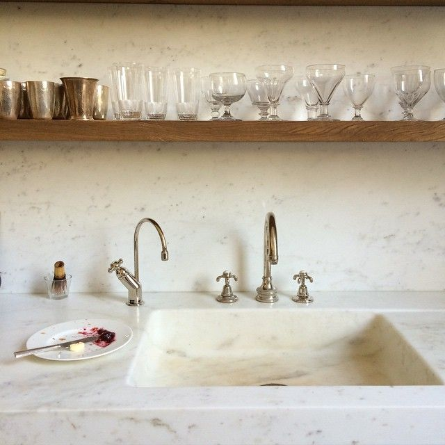 Marble kitchen sink detail and open shelf. Rose Uniacke's Classic Designed Minimal Home in London.