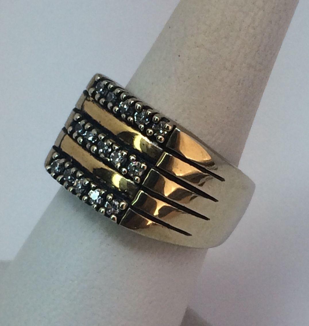 7ad3897f7029 Anillo en plata con aplicaciones en oro y circones